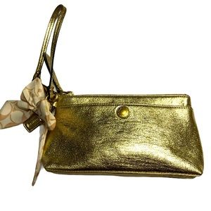 COACH gold metallic wristlet with little tie